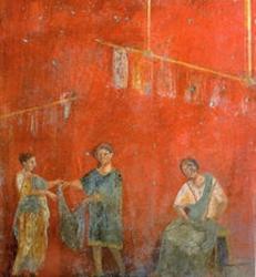 Mural de Pompeya que muestra a mujeres trabajando con un hombre en un comercio dedicado a la lavandería y a la tintorería (fullonica)